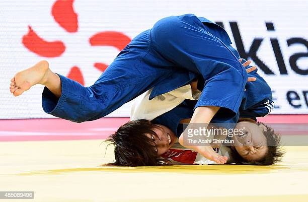 Ami Kondo of Japan and Jeong Bo Kyeong of South Korea compete in the Women's 48kg Quarter final during the 2015 Astana World Judo Championships at...