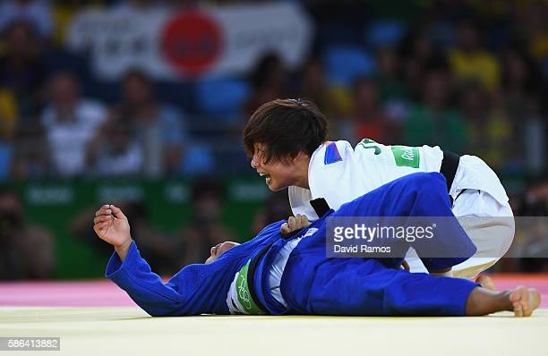 Ami Kondo of Japan celebrates after taking down Otgontsetseg Galbadrakh of Kazakhstan in the Women's 48 kg Judo on Day 1 of the Rio 2016 Olympic...