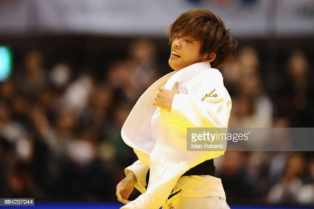 Ami Kondo of Japan celebrates victory in the Women's 48kg Final against Urantsetseg Munkhbat of Mongolia during day one of the Judo Grand Slam Tokyo...