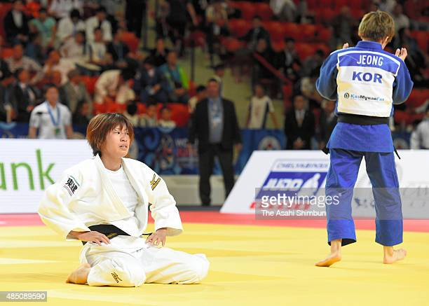 Ami Kondo of Japan reacts after her defeat by Jeong Bo Kyeong of South Korea in the Women's 48kg Quarter final during the 2015 Astana World Judo...
