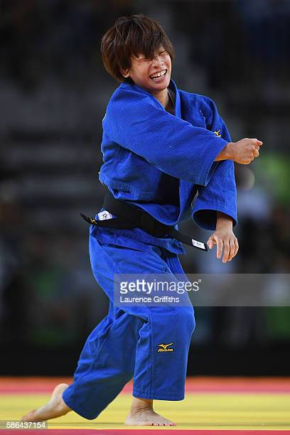 Ami Kondo of Japan reacts after taking down Urantsetseg Munkhbat of Mongolia during the women's 48kg Bronze Medal A judo contest on Day 1 of the Rio...