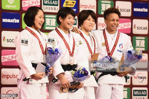 Ami Kondo of Japan smiles during the medal ceremony after winning the Women's 48kg Final against Urantsetseg Munkhbat of Mongolia during day one of...