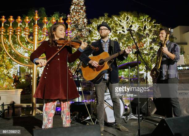 Ami Kozak Dov Rosenblatt and Dubid Swirsky of the band Distant Cousins perform at the Village Synagogue and Emmanuelle Chriqui Host Menorah Lighting...