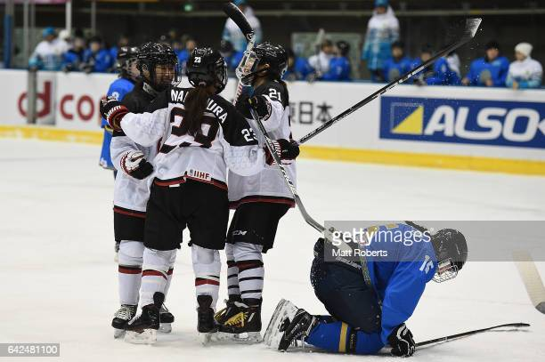 Ami Nakamura of Japan celebrates scoring a goal with team mates during the Women's Ice Hockey match between Kazakhstan and Japan on the day one of...