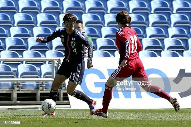 Ami Otaki of Japan challenges Zhou Feifei of China during the Algarve Cup 2013 fifth place match at the Estadio Algarve on March 13 2013 in Faro...