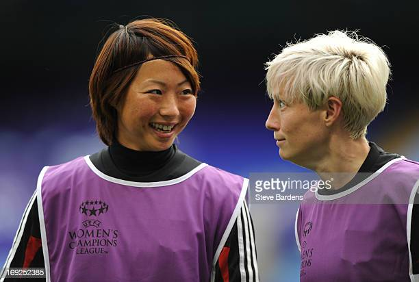 Ami Otaki of Olympique Lyonnais shares a joke with Megan Rapinoe during a training session ahead of the UEFA Women's Champions League Final at...
