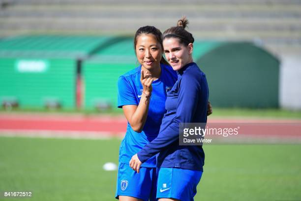 Ami Otaki of Paris FC and Charlotte Bilbault of Paris FC during a training session on September 1 2017 in Bondoufle France