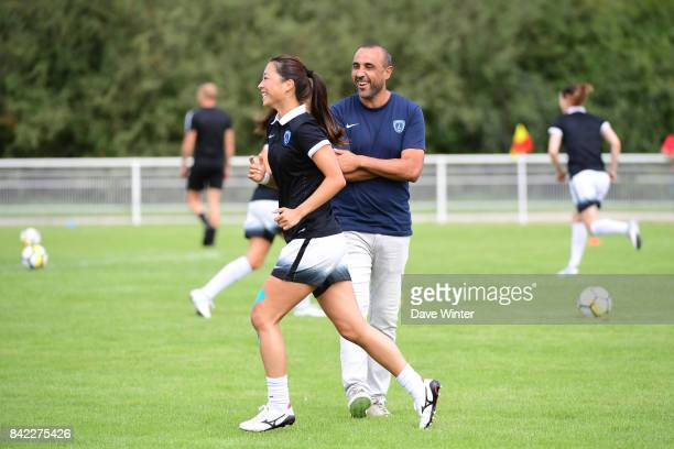 Ami Otaki of Paris FC and Paris FC coach Pascal Gouzenes before the women's Division 1 match between FC Fleury 91 and Paris FC on September 3 2017 in...