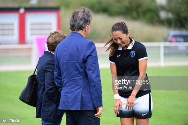 Ami Otaki of Paris FC bows to President of Paris FC Pierre Ferracci and Juvisy president Marie Christine Terroni before the club fusion with Paris FC...