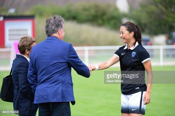 Ami Otaki of Paris FC greets President of Paris FC Pierre Ferracci and Juvisy president Marie Christine Terroni before the club fusion with Paris FC...