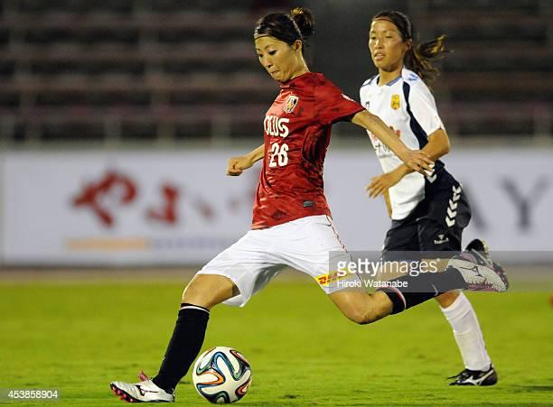 Ami Otaki of Urawa Reds Ladies shoots during the Nadeshiko League match between Urawa Red Diamonds Ladies and INAC Kobe Leonessa at Komaba Stadium on...