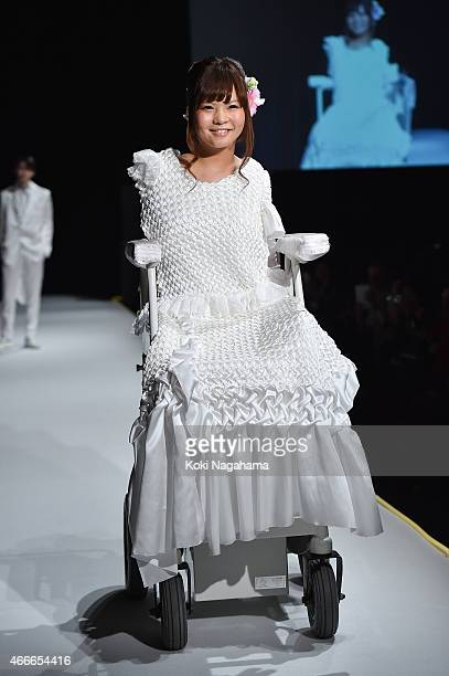 Ami Sano and male model showcase designs on the runway during the tenbo show as part of Mercedes Benz Fashion Week TOKYO 2015 A/W at Shibuya Hikarie...
