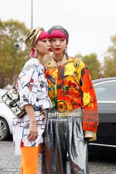 Ami Suzuki and Aya Suzuki of Amiaya wearing Chanel earrings, jacket and shoes outside Chanel during Paris Fashion Week Womenswear Spring Summer 2020...