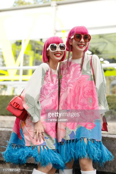 Ami Suzuki and Aya Suzuki of Amiaya wearing Valentino dress and bag outside Valentino during Paris Fashion Week Womenswear Spring Summer 2020 on...