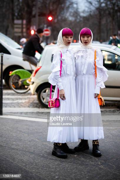 Ami Suzuki and Aya Suzuki wearing a long white dress Valentino boots and pink Valentino bag and long white dress Valentino boots and orange Valentino...