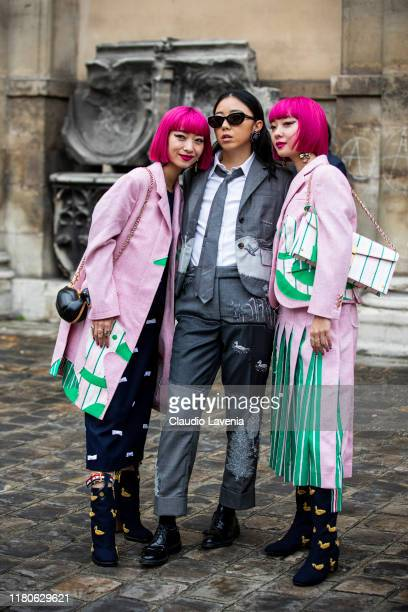Ami Suzuki , wearing a pink decorated coat, and blue decorated boots, Yuwei Zhangzou , wearing a grey decorated suit, and Aya Suzuki , wearing a pink...