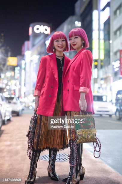 Amiaya are seen wearing pink blazers and skirts during the Amazon Fashion Week TOKYO 2019 A/W on March 21 2019 in Tokyo Japan