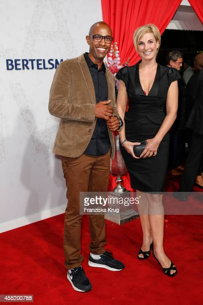 Amiaz Habtu and Britt Hagedorn attend the Bertelsmann Summer Party at the Bertelsmann representative office on September 10 2014 in Berlin Germany
