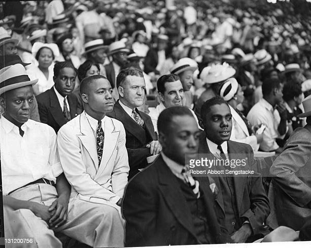 Amid a crowd of baseball spectators American newspaper publisher John H Sengstacke attends an EastWest All Star game in Comiskey Park Chicago...