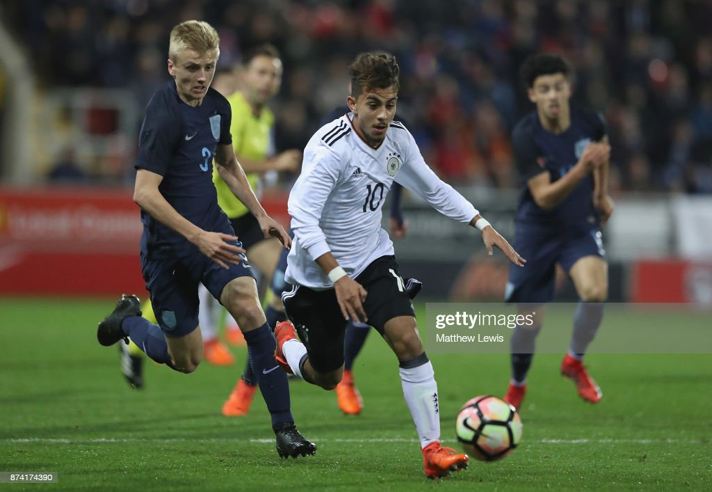 Amid Khan Agha of Germany beats the challenge from Louie Sibley of England during the International Match between England U17 and Germany U17 at The New York Stadium on November 14, 2017 in Rotherham, England.