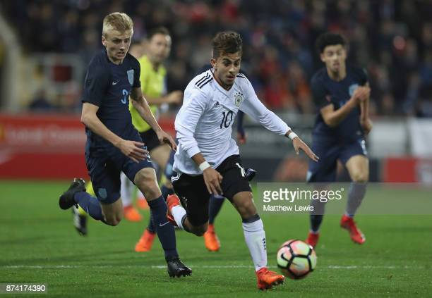 Amid Khan Agha of Germany beats the challenge from Louie Sibley of England during the International Match between England U17 and Germany U17 at The...