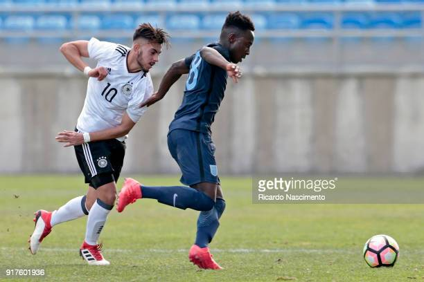 Amid Khan Agha of Germany U17 chalenges Arvin Appiah of England U17 during U17Juniors Algarve Cup match between U17 Germany and U17 England at...