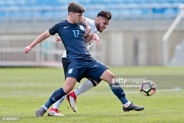 Amid Khan Agha of Germany U17 challenges Bobby Ducan of England U17 during U17Juniors Algarve Cup match between U17 Germany and U17 England at...