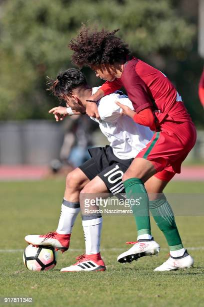 Amid Khan Agha of Germany U17 challenges Tomas Tavares of Portugal U17 during U17Juniors Algarve Cup match between U17 Portugal and U17 Germany at...