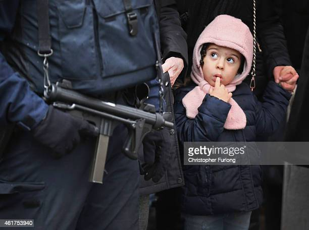 Amid tight security, members of the public arrive to pay their respects at the funeral of Charlie Hebdo cartoonist Bernard 'Tignous' Verlhac at Pere...