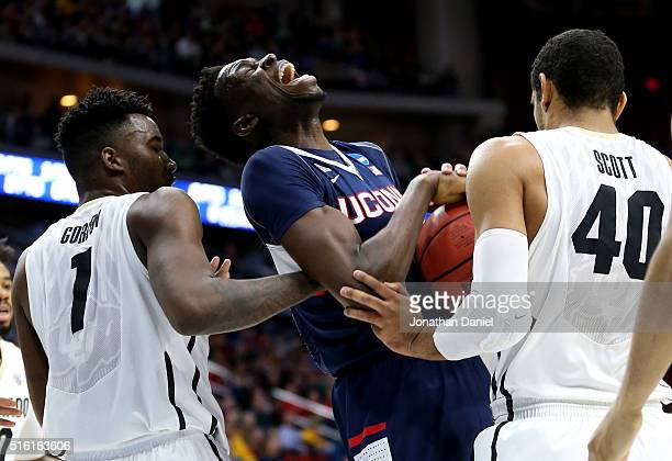 Amida Brimah of the Connecticut Huskies battles for a rebound with Wesley Gordon and Josh Scott of the Colorado Buffaloes in the first half during...