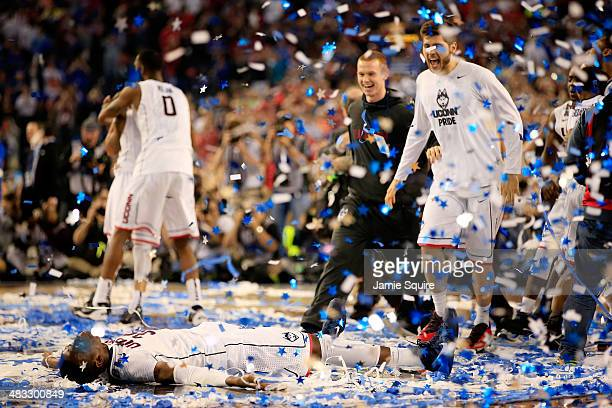 Amida Brimah of the Connecticut Huskies celebrates after defeating the Kentucky Wildcats 60-54 in the NCAA Men's Final Four Championship at AT&T...