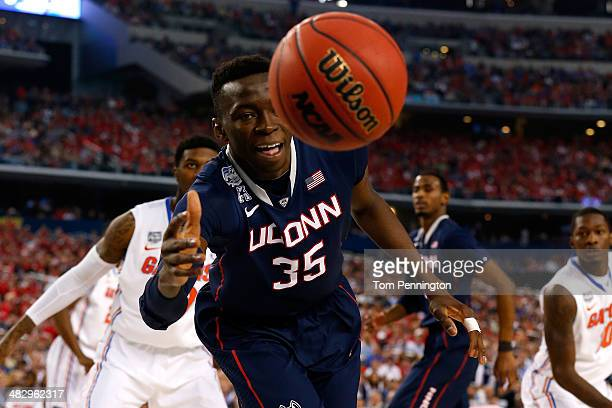 Amida Brimah of the Connecticut Huskies goes for a loose ball against the Florida Gators during the NCAA Men's Final Four Semifinal at ATT Stadium on...
