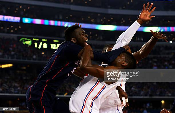 Amida Brimah of the Connecticut Huskies goes to the basket as Will Yeguete of the Florida Gators defends during the NCAA Men's Final Four Semifinal...