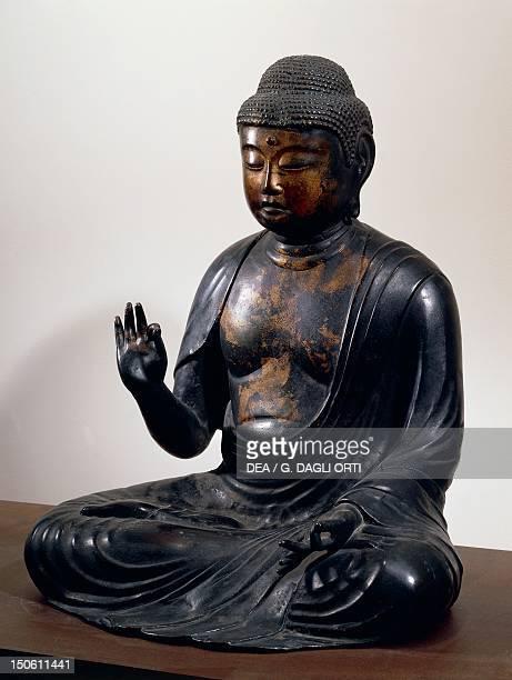 AmidaNyorai or Buddha Amitabha seated while listening bronze statue Japan Japanese Civilisation Heian period Fujiwara period 12th century