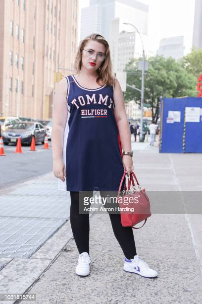 Amie Croft is seen wearing a Tommy Hilfiger jersey and a red Coach bag on the street during New York Fashion Week on September 11 2018 in New York...