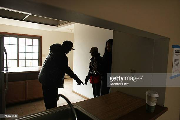 Amie Thompson and Kareem Rashed tour a basement with mold in a foreclosed home with realtor Tawanda Lockhart on March 12 2010 in Bridgeport...