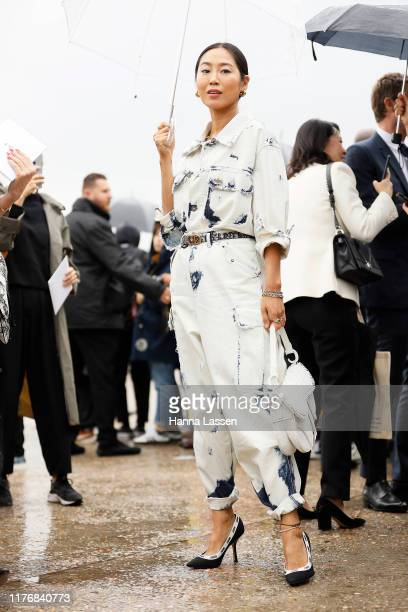 Amiee Song wearing Dior jumpsuit, clutch and shoes outside Dior on September 24, 2019 in Paris, France.