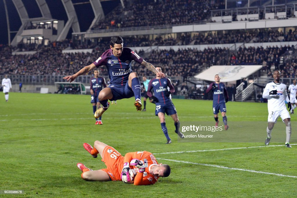 Amien goalkeeper Jean-Christophe Bouet catches the ball in front of Angel Di Maria of Paris Saint-Germainduring the League cup match between Amiens and Paris Saint Germain at Stade de la Licorne on January 10, 2018 in Amiens, France.