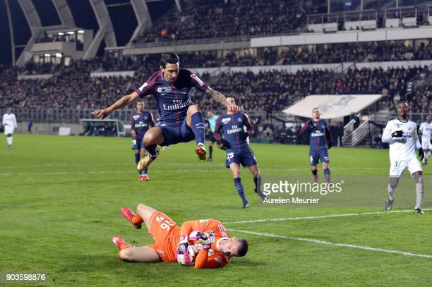 Amien goalkeeper JeanChristophe Bouet catches the ball in front of Angel Di Maria of Paris SaintGermainduring the League cup match between Amiens and...