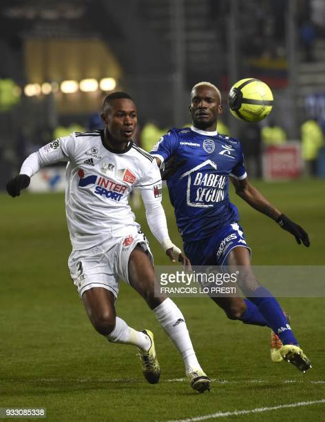 Amiens' Amiens' Beninese defender Khaled Adenon vies with Troyes' Malian forward Adama Niane during the French L1 football match between Amiens and...
