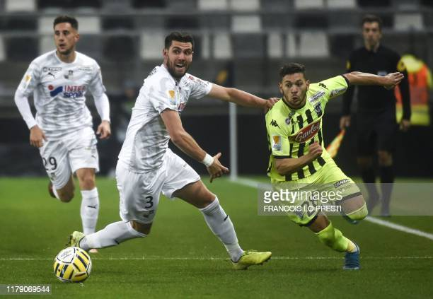 Amiens' Arturo Calabresi vies with Angers' Farid El Melali during the French Ligue Cup round of 32 football match between Amiens and Angers on...