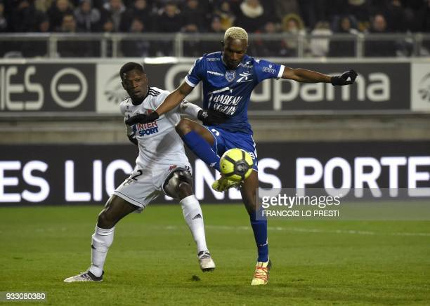 Amiens' Bakaye Dibassi vies with Troyes' Malian forward Adama Niane during the French L1 football match between Amiens and Troyes on March 17 2018 at...