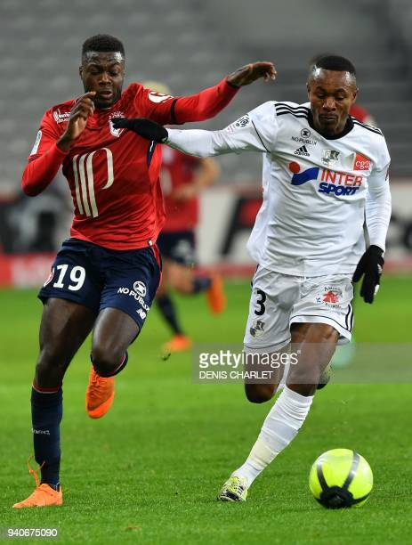 Amiens' Beninese defender Khaled Adenon outruns Lille's Ivorian forward Nicolas Pepe during the French L1 football match played behind closed doors...