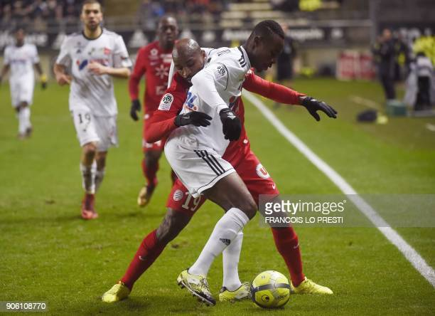 Amiens' Beninese defender Khaled Adenon vies with Montpellier's Senegalese forward Souleymane Camara during the French L1 football match between...