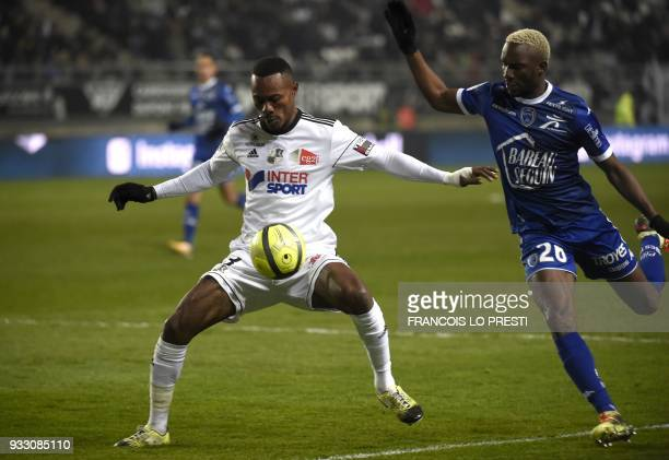 Amiens' Beninese defender Khaled Adenon vies with Troyes' Malian forward Adama Niane during the French L1 football match between Amiens and Troyes on...