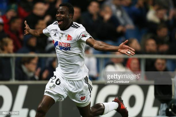 Amiens' Cameroonian midfielder Guy Ngosso celebrates after scoring goal during the French L1 football match between Amiens and Bordeaux on October 21...