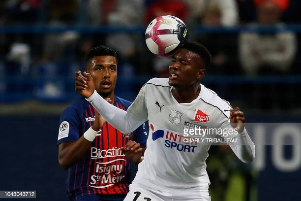 Amiens' Colombian forward Juan Otero Tovar vies for the ball with Caen's French defender Yoel Armougom during the French L1 football match between...