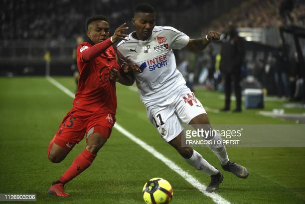 Amiens' Colombian forward Juan Otero vies with Nice's French defender Patrick Burner during the French L1 football match between Amiens and Nice on...