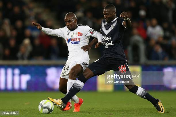 Amiens' forward Gael Kakuta vies for the ball with Bordeaux's Senegalese midfielder Younousse Sankhare during the French L1 football match between...