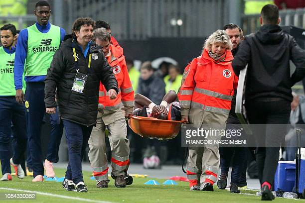 Amiens' forward Moussa Konate is evacuted on a stretcher after an injury during the French L1 football match between Amiens SC and FC Nantes at the...